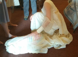 Lain hides in the wedding gown.